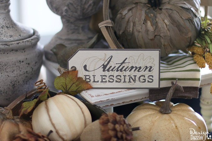 Fall is one of my favorite seasons to decorate. I'm sharing my go to DIY tutorial on creating a fall centerpiece with step-by-step photos here! These gorgeous farmhouse ideas are perfect for your home decor this fall season. #fall #falldecorideas #centerpiece #diyhomedecor #DIY || Design Dazzle