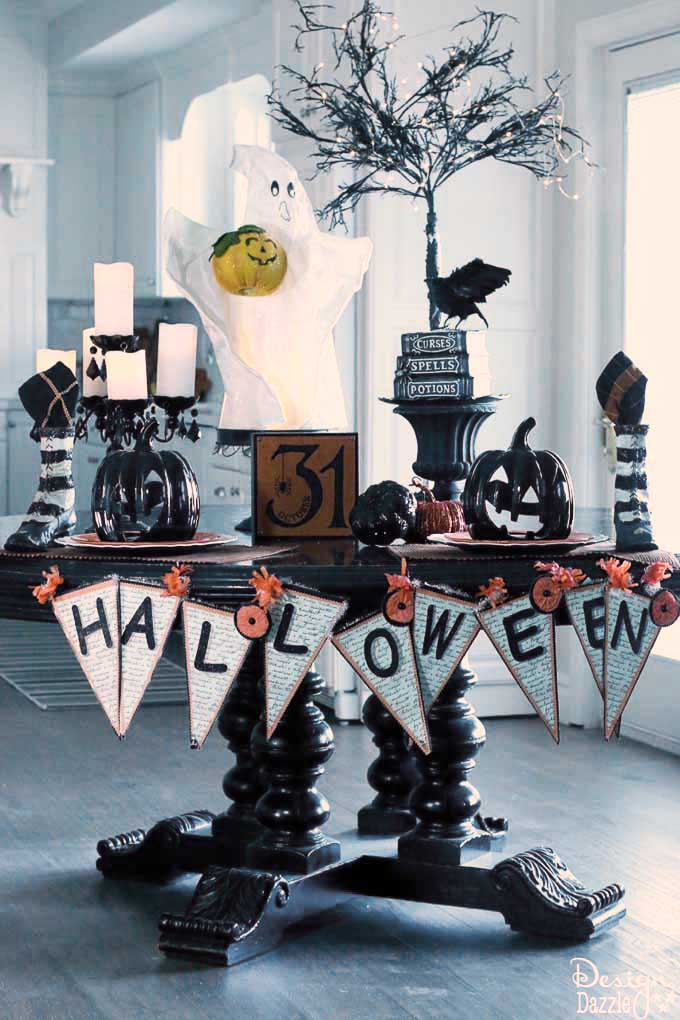 Having a cute Halloween tablescape is my favorite part of my Halloween decor! See how I used my kitchen table as the highlight of my decorations. | halloween decor ideas | decorating for halloween | halloween tablescape ideas || Design Dazzle
