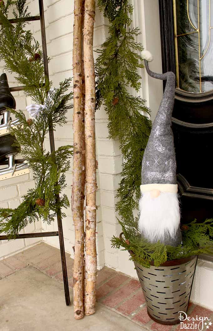 My black and white Christmas porch is a different twist on your typical Christmas porch decor and I think you'll love how it turned out!   holiday porch decor   outdoor decor for Christmas   Christmas porch decor   black and white holiday decor   black and white Christmas decor    Design Dazzle #christmasporch #holidayporch #outdoorchristmasdecoration