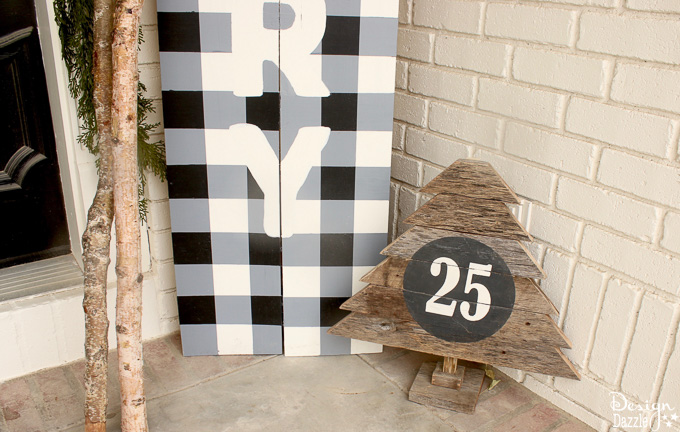 My black and white Christmas porch is a different twist on your typical Christmas porch decor and I think you'll love how it turned out! | Design Dazzle