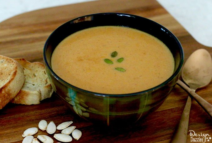 This pumpkin soup recipe is yummy and it freezes easily! It's the perfect meal for around the holidays! It's cozy, warm, fast, easy, and delicious. | homemade pumpkin recipes | fall soup recipes | pumpkin soup recipe | healthy soup recipe | fall recipe ideas || Design Dazzle #souprecipes #pumpkinsoup #pumpkinrecipe #fallrecipes