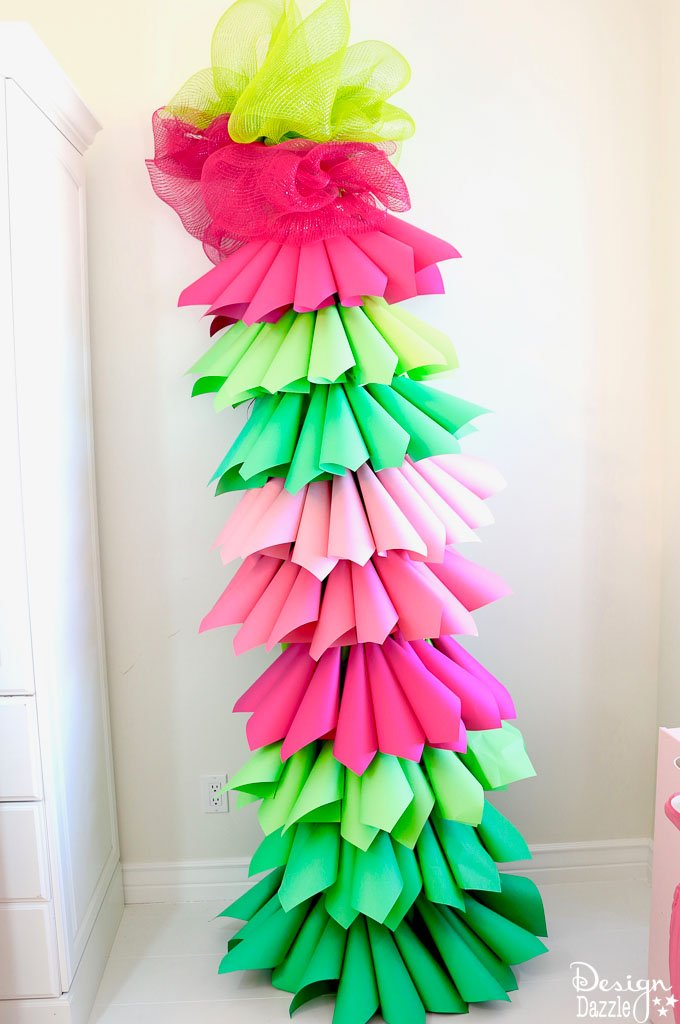 Design Dazzle shows you how to make a paper cone Christmas tree for the perfect Grinch party. Grinch Paper Cone Christmas Tree | grinch holiday decorations | grinch party decor | grinch inspired holiday party | diy grinch decor || Design Dazzle #grinchtree #grinchdecor #grinchparty