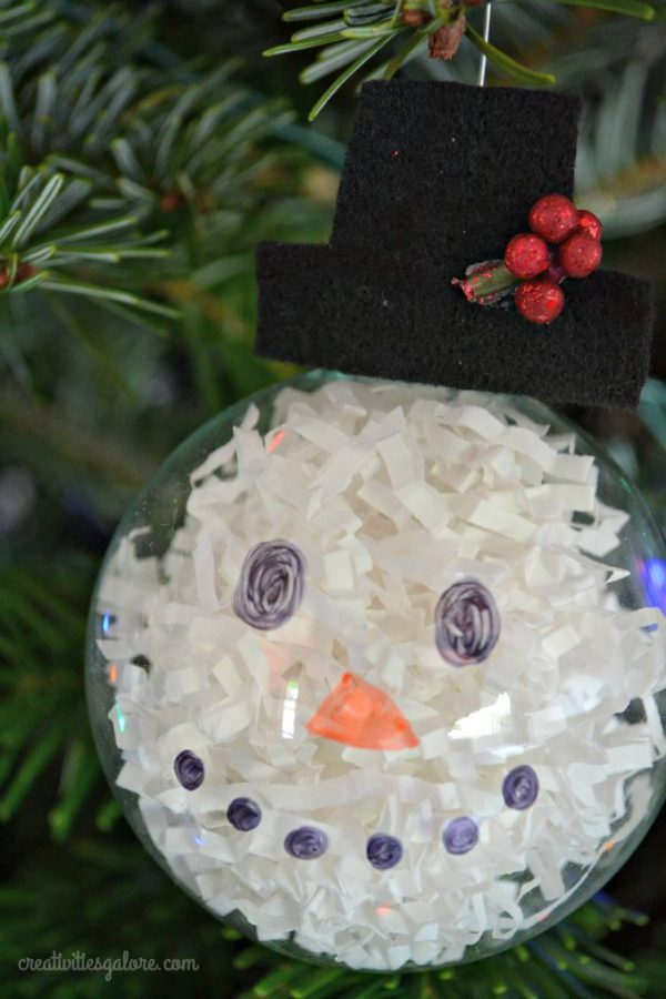 Want a fun and easy activity to do at a Christmas party? Then this DIY snowman ornament is the perfect craft for you and your guests.
