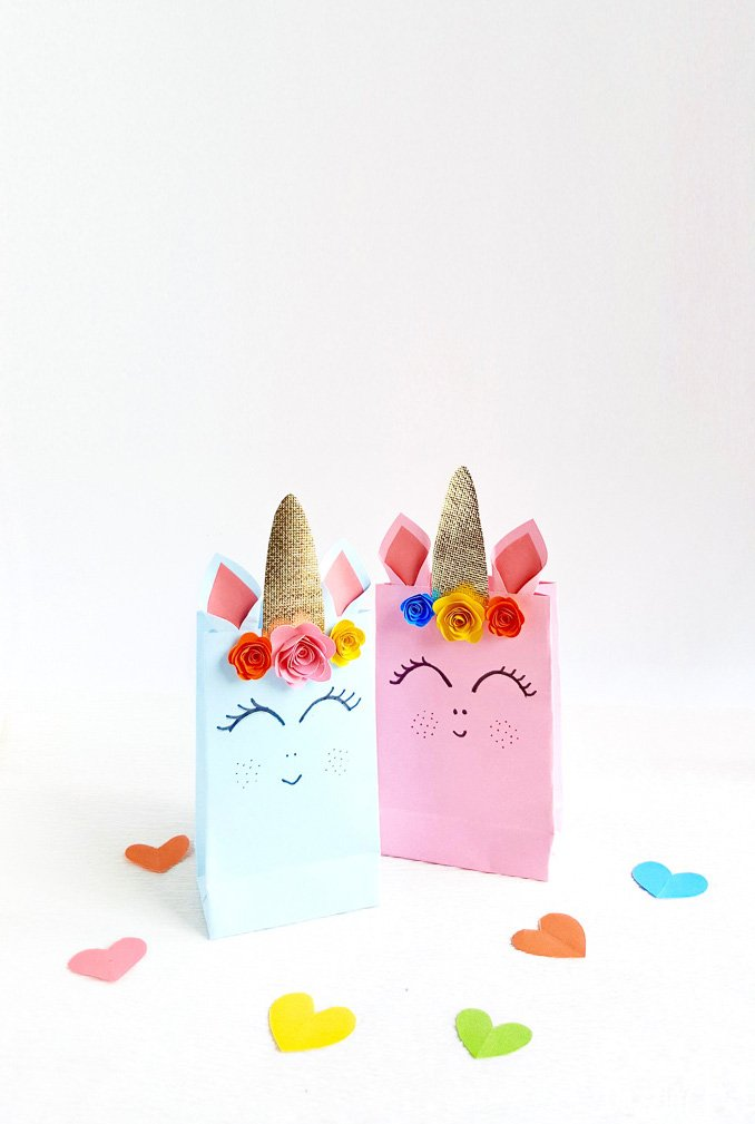 We are sharing simple step by step instructions for these adorable Unicorn Gift Bags plus a free pattern! | Design Dazzle