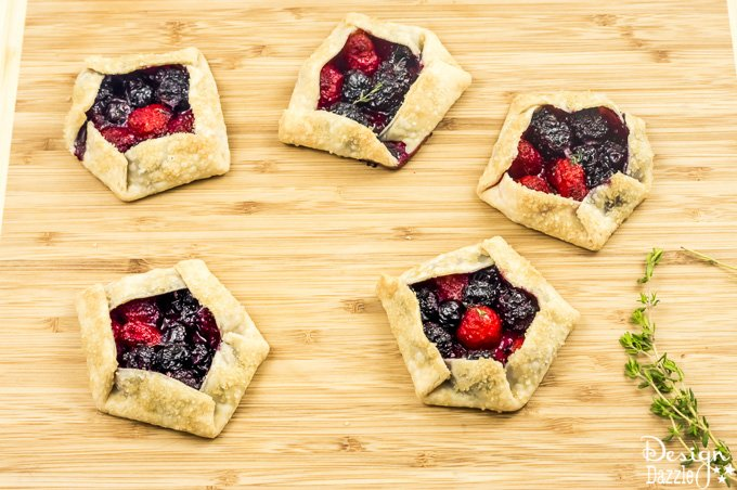 Not only are these Mini Mixed Berry Galettes absolutely delicious but they are gorgeous too! Perfect for a wedding shower, spring party, or even a summer barbecue! | Design Dazzle