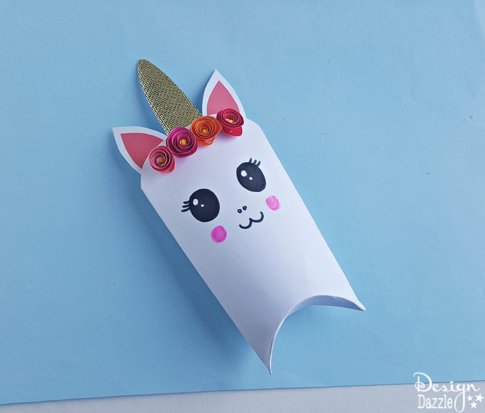 Unicorns are all the rage these days! Here is an adorable unicorn favor box and free template that will bring magic to every party | Design Dazzle