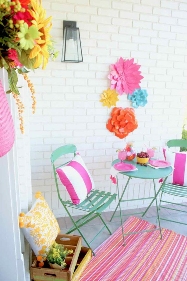 Front Porch Summer Decor. Beautiful hues of pink, yellow, orange, and more make for a colorful and happy porch | Design Dazzle