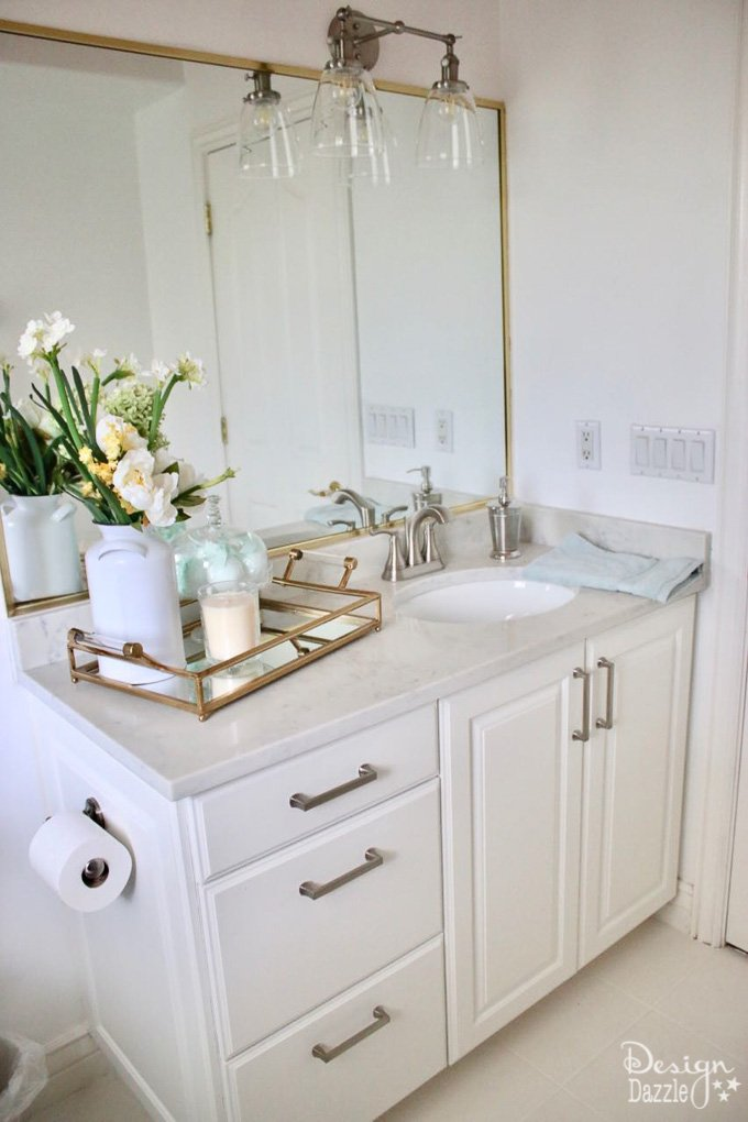 Tiling doesn't have to be difficult! As part of mybathroom remodel I'm showing you how I used Tic Tac Tiles to make my tiling process easy peasy! | Design Dazzle