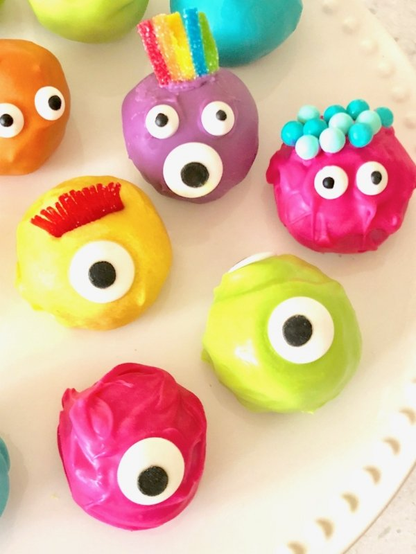 TWO ingredients and then dipped the Oreo Truffle balls in melted candy and you've got some VERY CUTE colorful monster Oreo truffle balls! - Design Dazzle