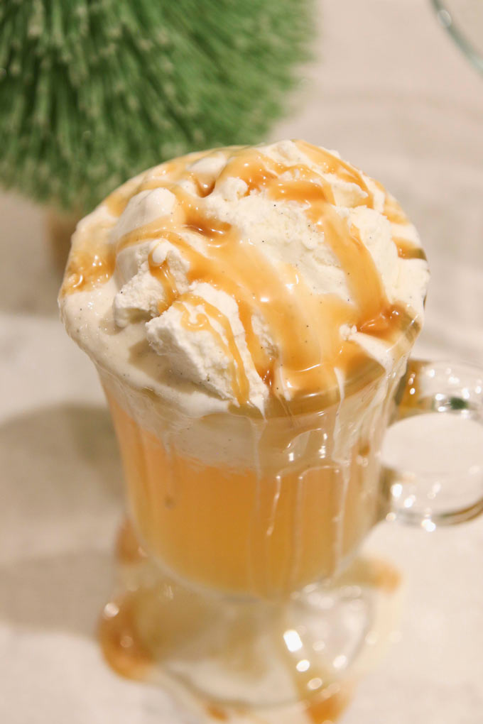 Add a scoop of ice cream to warm apple cider. It's delicious!!! Drizzle some Torani Caramel Syrup for just the perfect topping. | Design Dazzle