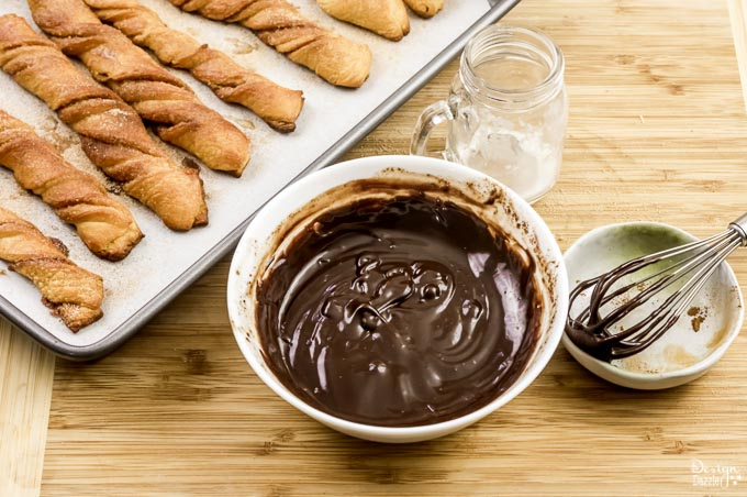 These Baked Churros with Chocolate Sauce are made with refrigerated crescent dinner roles. So pretty simple to make. Check them out! - Design Dazzle