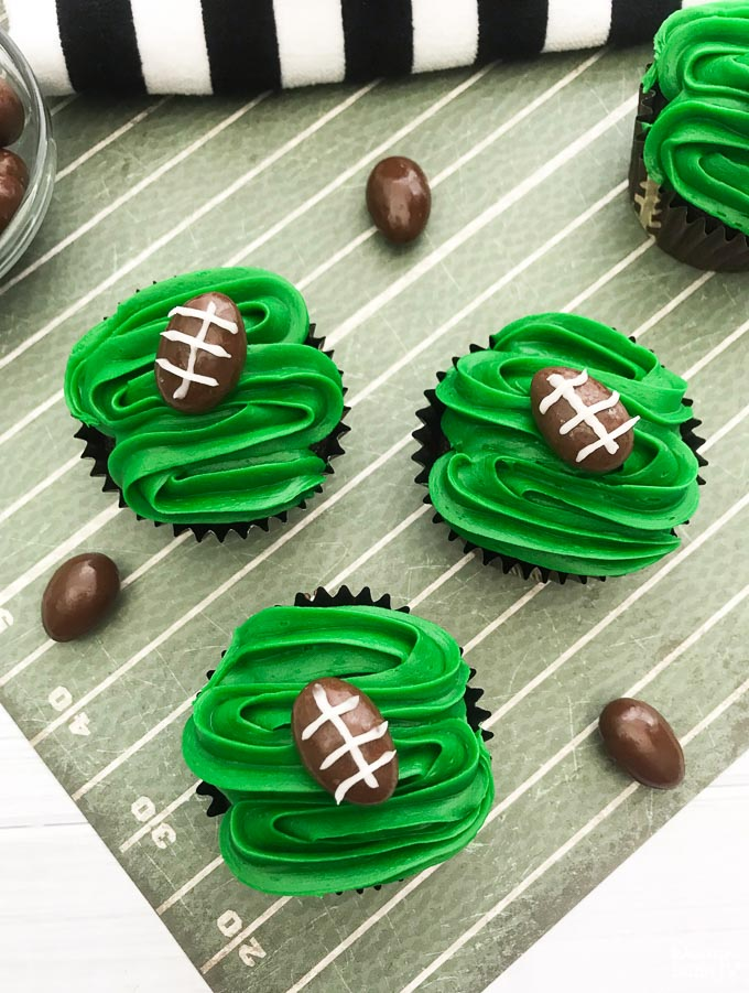 These are definitely the easiest football cupcakes you will ever make. They are also absolutely delicious, your guests and party-goers will love them! | Design Dazzle