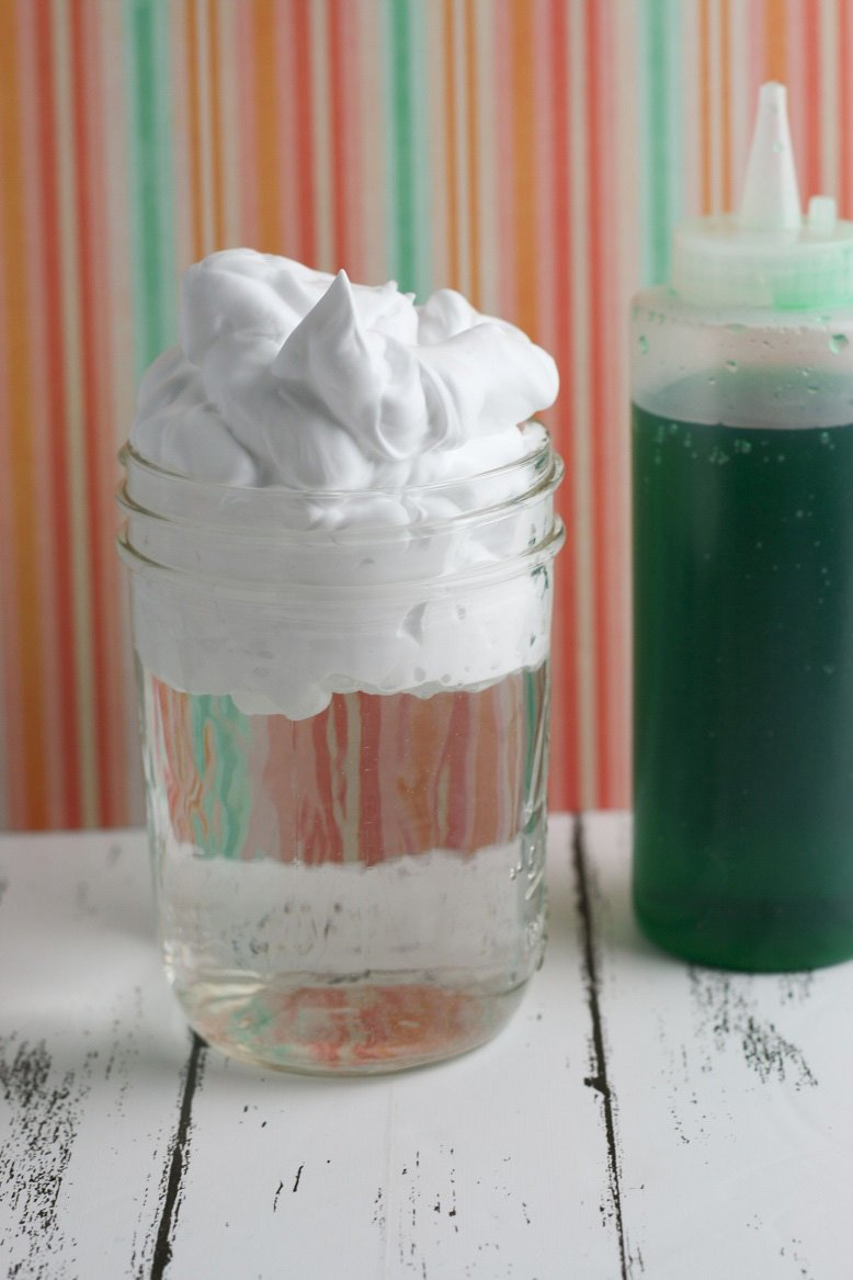 These shaving cream rain clouds are a simple but fun science experiment for kids! It's a great teaching tool on how rain is produced. It's also a cool boredom buster, a great indoor activity for kids this winter or any season of the year! - Design Dazzle