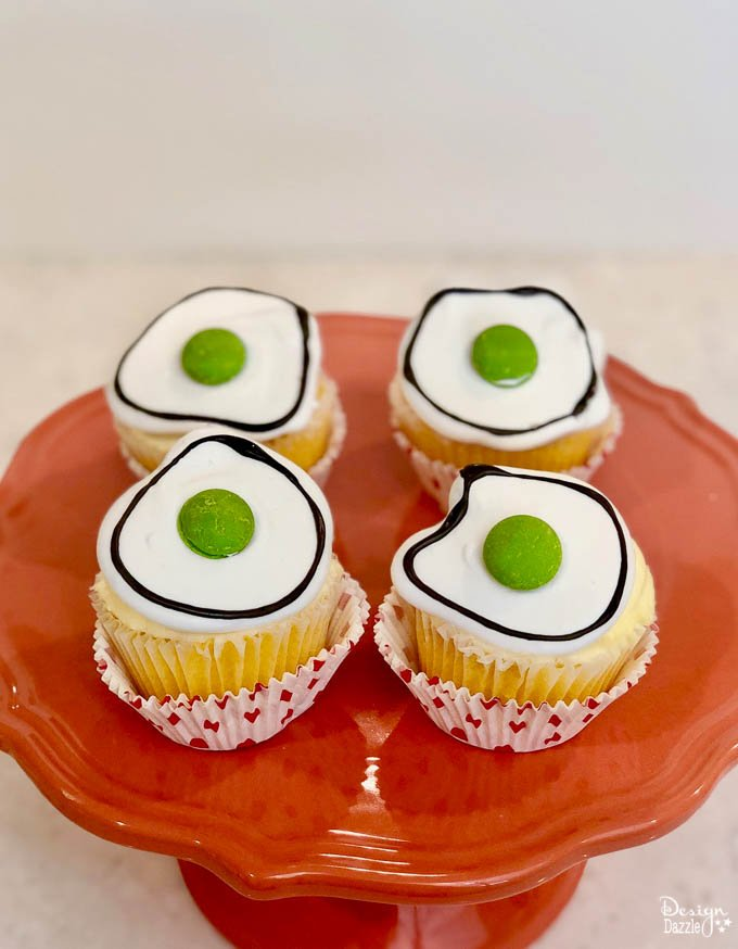 Did you know that March 2nd is Dr. Seuss' birthday? What a better way to celebrate than with making these adorable Dr. Seuss Green Eggs Cupcakes! | Design Dazzle