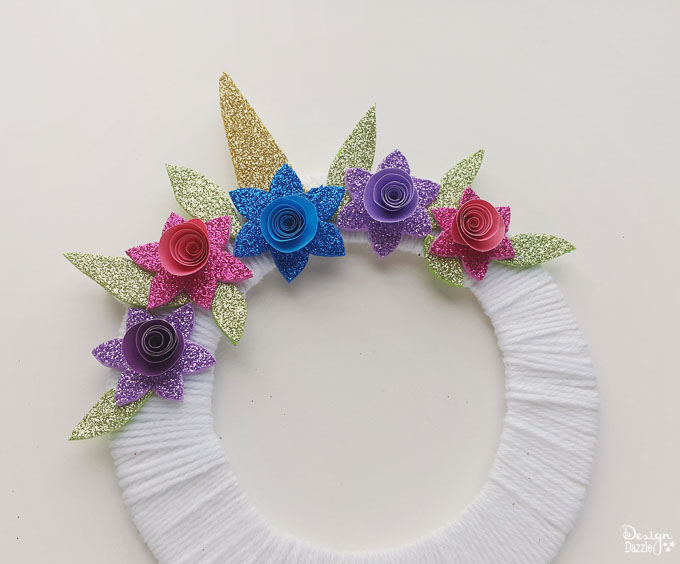 Make this super cute DIY unicorn wreath for your kid's room! It's so quick and easy to make! It's also a nice decor for your unicorn themed party! - Design Dazzle