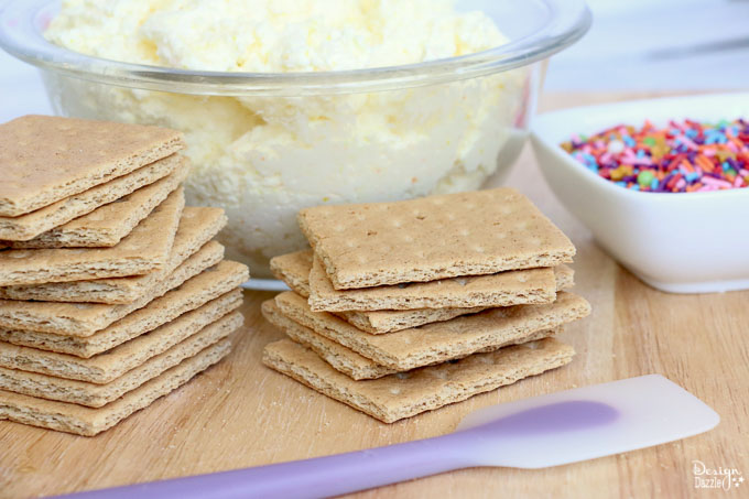 These cute stuffed graham crackers are a great afternoon snacks for the kiddos! Absolutely easy to make! Have fun preparing them, especially when it comes to the sprinkles! - Design Dazzle