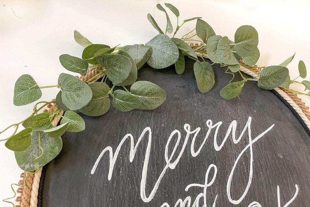 add greenery to wreath