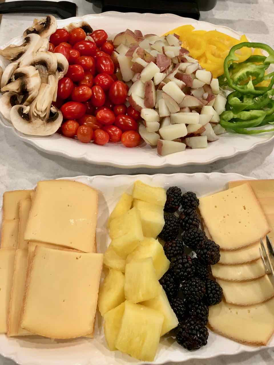 Raclette for Christmas or New Years. Perfect meal for a group dinner party or easy dinner for the family!