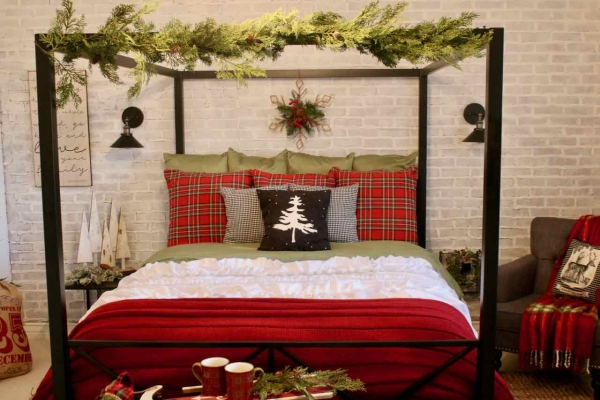 Decorating the bedroom for the holidays with plaid and Christmas greenery!